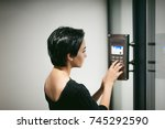 woman is calling on the intercom | Shutterstock . vector #745292590