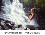 young girl in lotus position... | Shutterstock . vector #745294693