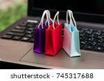 three colorful paper shopping... | Shutterstock . vector #745317688