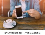 hand woman using smartphone in... | Shutterstock . vector #745323553