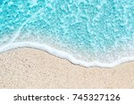 sea beach and soft wave of blue ... | Shutterstock . vector #745327126
