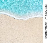 sea beach and soft wave of blue ... | Shutterstock . vector #745327333