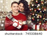happy couple give gifts in... | Shutterstock . vector #745338640