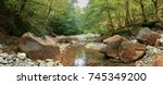 mountain river in the forest.... | Shutterstock . vector #745349200