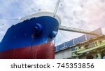 ship repair in floating dry... | Shutterstock . vector #745353856