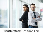 a business man and woman... | Shutterstock . vector #745364170