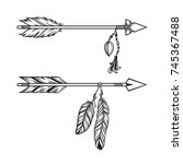 tribal arrows with pendants of...