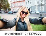 pretty young woman in glasses... | Shutterstock . vector #745379320