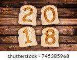 2018 greeting card toasted... | Shutterstock . vector #745385968