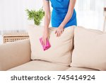 woman cleaning couch with... | Shutterstock . vector #745414924