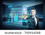 young businessman using digital ... | Shutterstock . vector #745416568