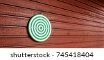 darts is hanging on the wooden... | Shutterstock . vector #745418404