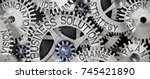 Small photo of Macro photo of tooth wheel mechanism with BUSINESS SOLUTION, PLAN, STRATEGY, CHANGE, INNOVATION, VISION, TEAMWORK and IDEA words imprinted on metal surface
