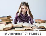 student studying on the table | Shutterstock . vector #745428538