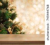 christmas tree branch behind... | Shutterstock . vector #745444768