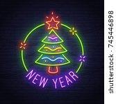christmas tree neon sign. neon... | Shutterstock .eps vector #745446898