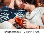 beautiful couple sitting on the ... | Shutterstock . vector #745447726