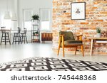 poster on red brick wall above... | Shutterstock . vector #745448368