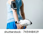 young woman with wearable... | Shutterstock . vector #745448419