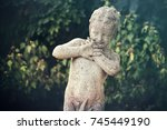 statue of scared little boy ... | Shutterstock . vector #745449190