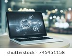 laptop with abstract ico... | Shutterstock . vector #745451158