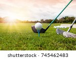 golf club and golf ball in... | Shutterstock . vector #745462483