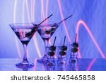 two glasses with martini and