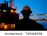 Silhouette Of Oil Rig Operator...