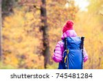 hiking woman with backpack... | Shutterstock . vector #745481284