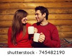 man and woman drinking tea at... | Shutterstock . vector #745482190