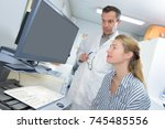 doctor and medical secretary | Shutterstock . vector #745485556