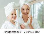 beautiful happy mother and... | Shutterstock . vector #745488100