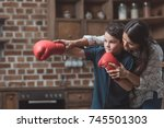 young mother teaching her... | Shutterstock . vector #745501303