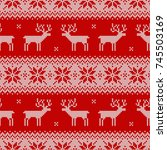 knitted seamless pattern with... | Shutterstock .eps vector #745503169