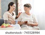 nurse and senior woman having... | Shutterstock . vector #745528984