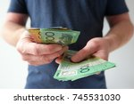 man handling hundred and fifty... | Shutterstock . vector #745531030