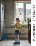 child little girl is cleaning... | Shutterstock . vector #745531489
