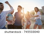 young women dancing with their... | Shutterstock . vector #745533040