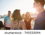 happy group of friends dancing... | Shutterstock . vector #745533094