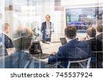 businessman giving a talk in... | Shutterstock . vector #745537924