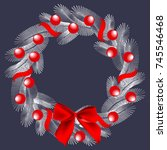 white fir tree wreath with red...