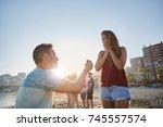 man proposing to his girlfriend ...   Shutterstock . vector #745557574