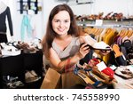 glad young brunette buying...   Shutterstock . vector #745558990