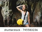 young woman traveler at cave...   Shutterstock . vector #745583236