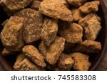 jaggery or gur with sugar cane... | Shutterstock . vector #745583308