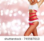 slim woman body on an abstract... | Shutterstock . vector #745587013