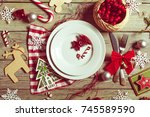 christmas table place setting | Shutterstock . vector #745589590