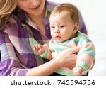 mum with her baby  on a white... | Shutterstock . vector #745594756