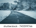 curved asphalt path in snow... | Shutterstock . vector #745599766