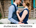 husband hugs woman  holds in... | Shutterstock . vector #745603306